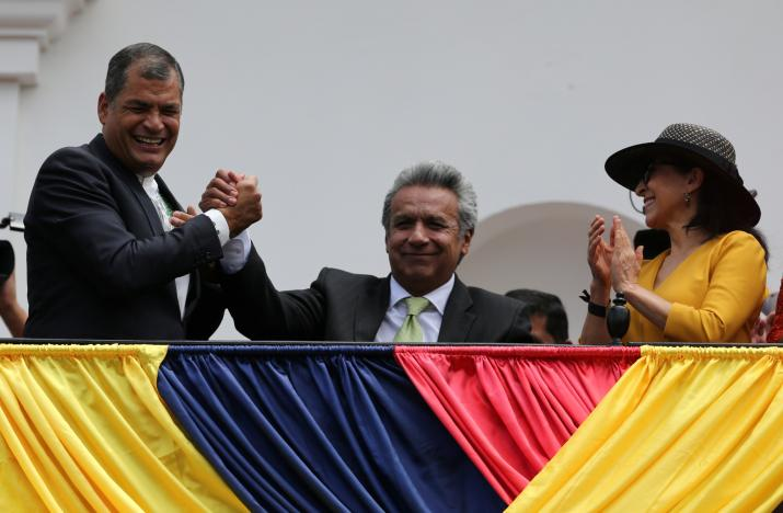 Ecuador's President Rafael Correa greets Presidential candidate Lenin Moreno next to his wife Rocio Gonzalez as they stand on the government palace's balcony during a military change of guard ceremony in Quito